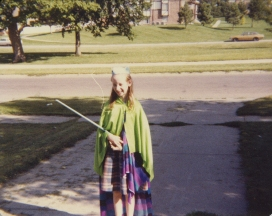 "At the age of seven or eight playing ""queen"" with a paper crown and scepter"