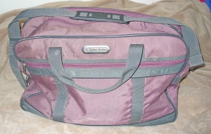 Gifted to me when I was 18, this soft-sided carry on  bag has been with me on every flight I've ever taken.  It readily fits under the seat in front of me on even the smallest plane.