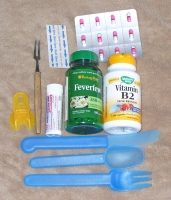 Pack medicines and first aid kit into the carry on.  Band-aids, prescription medicine (B2 & Feverfew are dr. prescribed for me), motion sickness pils, and anti-allergy pills are critical.  I also packed plastic cutlery, a seafood fork for my veggies, and a soda can opener.